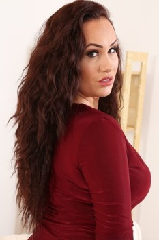 British doll Becky Dee teases with killer curves as she strips to pantyhose