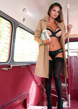 Black stockings clad glamour girl Dana Harem baring big tits on the bus
