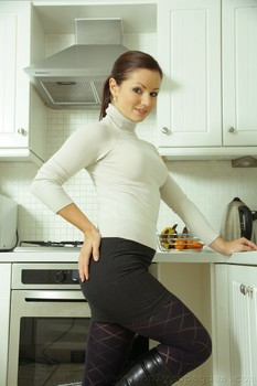 Young housewife Jana B undresses in the kitchen & shows her hot ass and muff