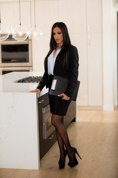 Israeli businesswoman Layla Sin strips & poses in her lingerie in the kitchen