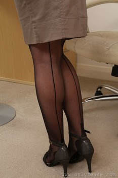 Hot secretary Victoria S flashing her big tits and posing in sexy lingerie