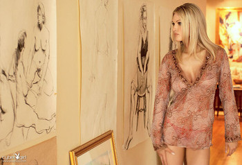 Glamour girl Nikki Kelley teases on the floor & flaunts big tits on the sofa