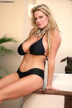 Pretty MILF with big bosoms Kelly Madison strips her bikini & poses in jacuzzi